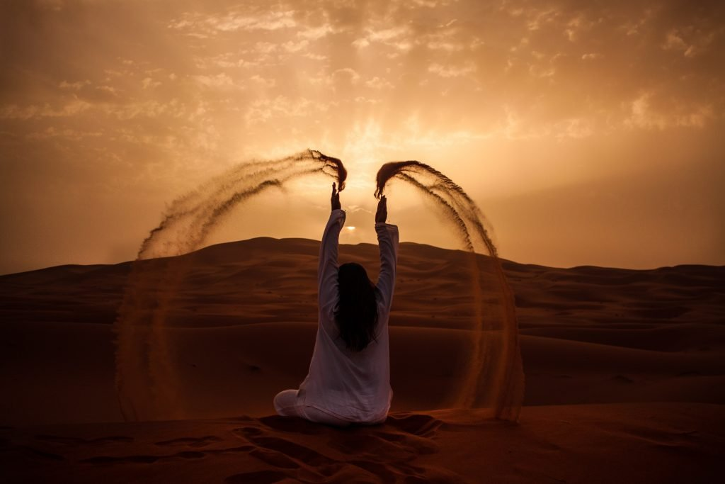 Woman Happily Plays With Sand In Desert Sunset Changing Habits Blog Gorilla Jobs