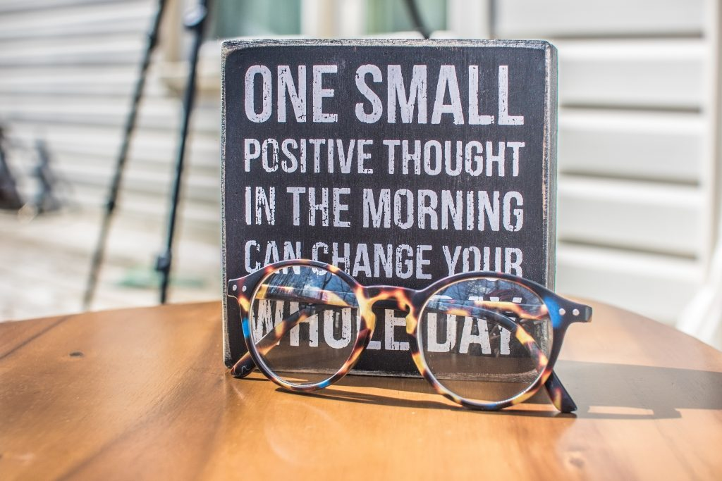 Gorilla Jobs Blog Staying Positive During Lockdown Positive Motivational Quote On Card With Glasses In Front