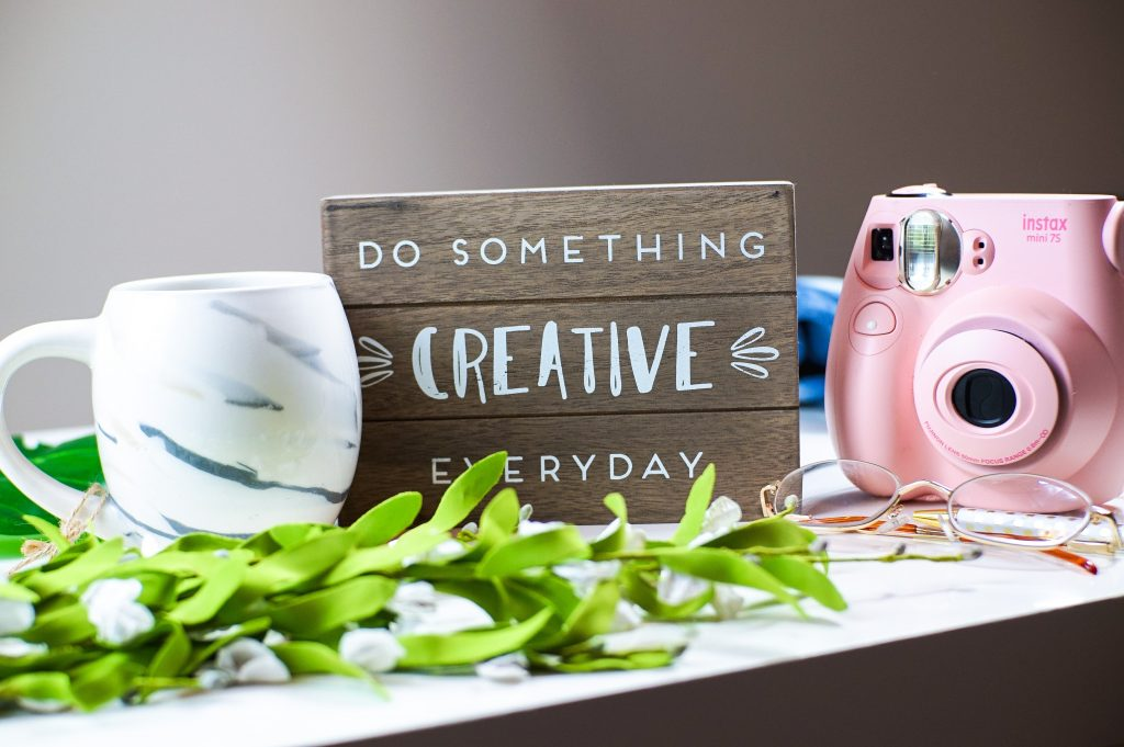 Gorilla Jobs Blog Stay Active During Lockdown Do Something Creative Sign With Coffee Cup and Camera on Table